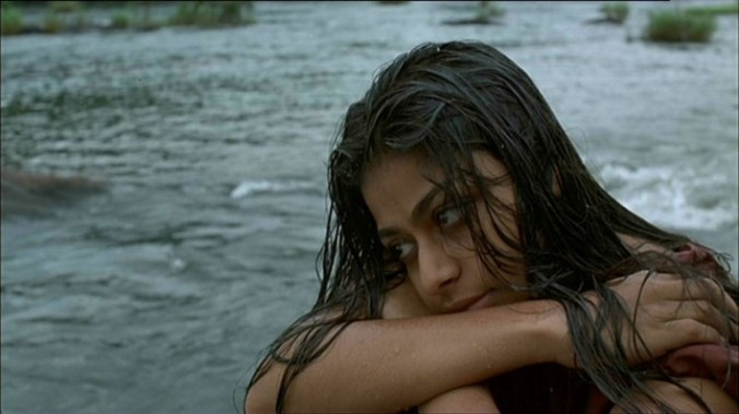 Ayesha Dharker as Malli in one of several scenes by water.