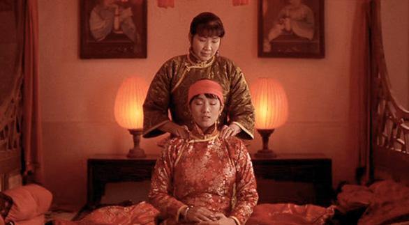Songlian (Gong Li) receives a massage.