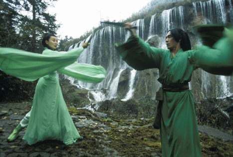 Maggie Cheung and Tony Leung in the green sequence.