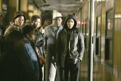 The gang aboard the train in the opening sequence.