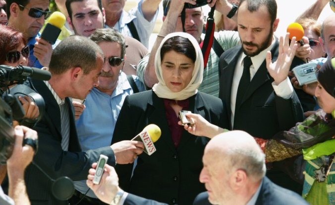 Salma and her lawyer are mobbed by the media outside the Supreme Court.