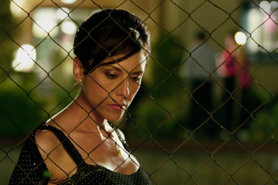 Rona Lipaz-Michael plays Mira, here pensive on the 'other side' of the wire which 'protects' her from the lemon grove.