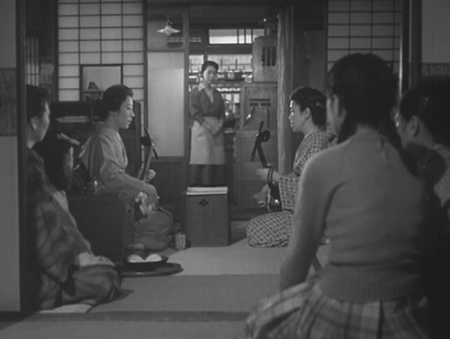 A music lesson in the geisha house. The maid standing in the background is played by the marvelous Tanaka Kinuyo