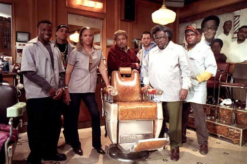 The barbers with Calvin/Ice Cube (centre) and Cedric the Entertainer to the right of the chair.