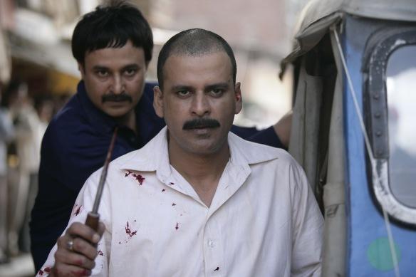 Manoj Bajpayee as Sardar Khan and behind him Jameel Khan as Asghar Khan
