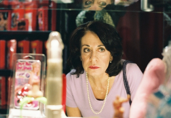 Rosita (Mariana Cordero) browses a sex shop in the hope of finding something to stimulate her husband.