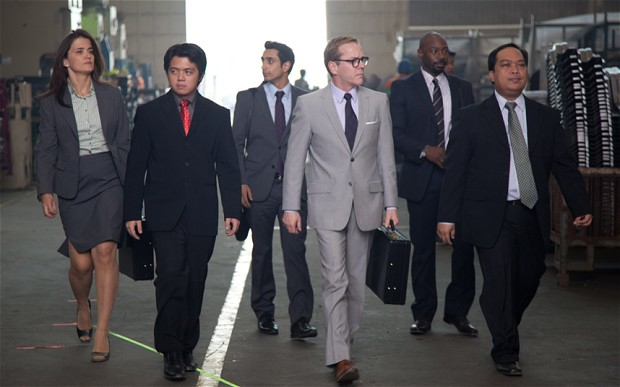 Riz Ahmed as Changez (centre back) behind Kiefer Sutherland as his boss on a trip to the Philippines to make a car plant more productive (and lose jobs).
