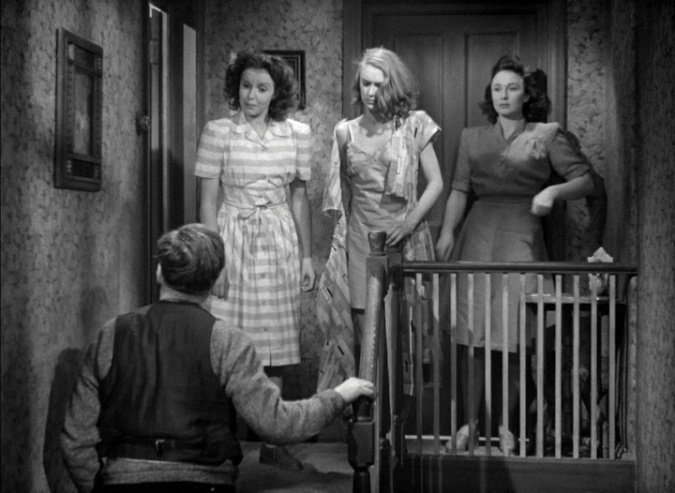 The family melodrama: after a violent argument with her stepmother (Susan Shaw) has a torn dress – a reference to the cheap austerity clothes? Edward Chapman, the girls' father is coming up the stairs.