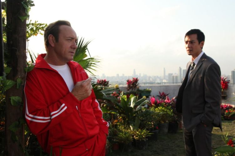 'Chuck' (Kevin Spacey) and Li (Daniel Wu) meet on the top of Li's apartment block.