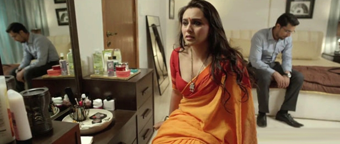 Rani Mukerji and Randeep Hooda in the Karan Johar segment. The careful composition tells you everything about the marriage.