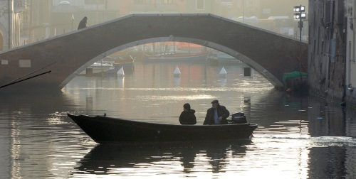 Bepi and Shun Li in his boat.