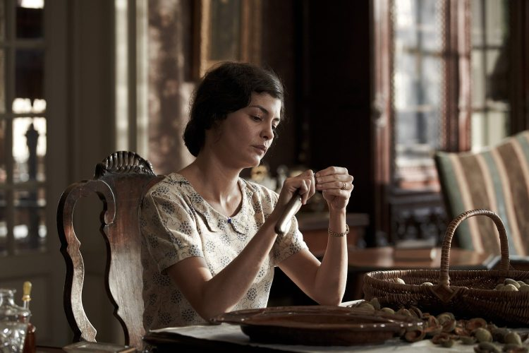 Thérèse shells almonds in the dark house – her calm in contrast with the rising sense of disturbance in the household.