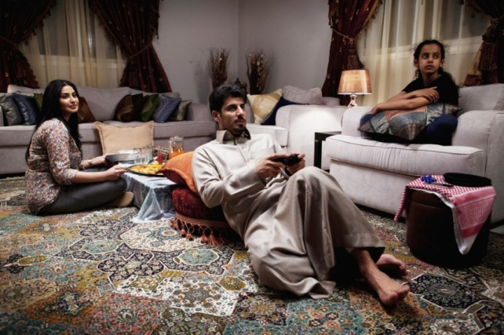Wadjda's father on one of his irregular visits to the apartment plays a videogame – a family scenario familiar from scenes of middle-class homes in many countries