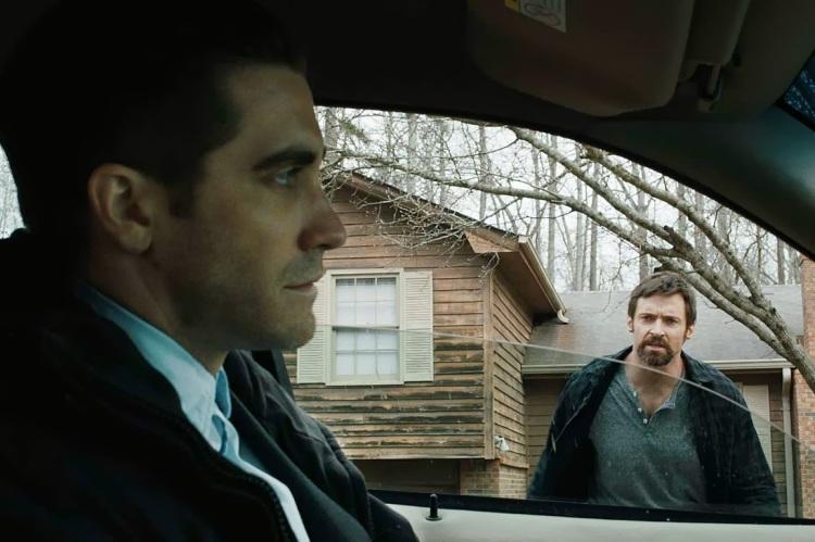Detective Loki (Jake Gyllenhaal) and Dover (Hugh Jackman)