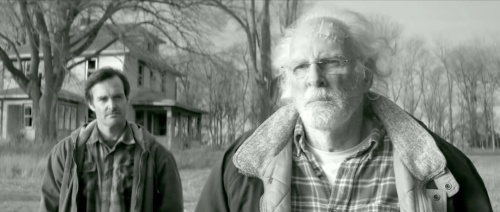 Father and son outside the old family house in Hawthorne, Nebraska