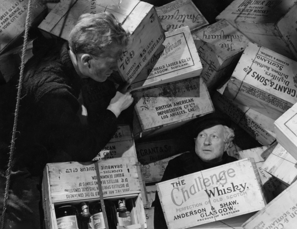 George (Gordon Jackson) rescues The Biffer (Morland Graham) as the SS Cabinet Minister threatens to sink.