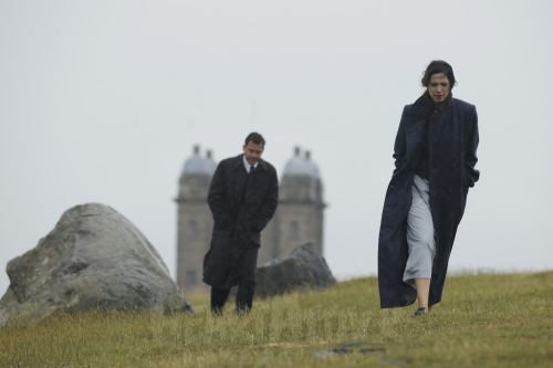 Rebecca Hall (Florence) and Dominic West (Robert) on the moors above the school.