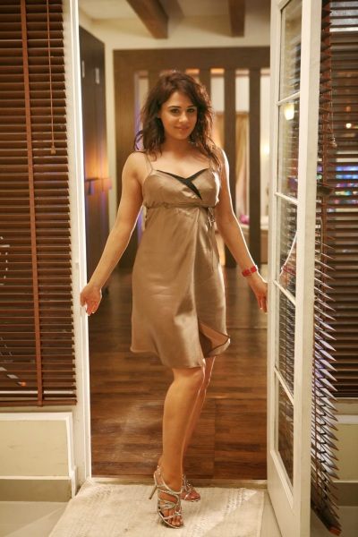 Mandy Takhar as Maya, the femme fatale