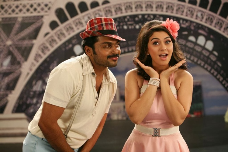 Karthi and Hansika Motawi in one of the dance sequences which seems to refer to the stage sets of MGM musicals such as 'An American in Paris'