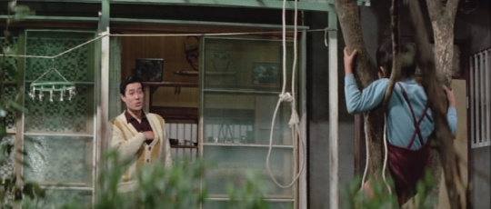 One of the disturbing sights facing the protagonist in THE SHADOW WITHIN. Is that a noose fashioned by the child or is he attempting to set up a swing? (from http://rozmon.blogspot.co.uk)