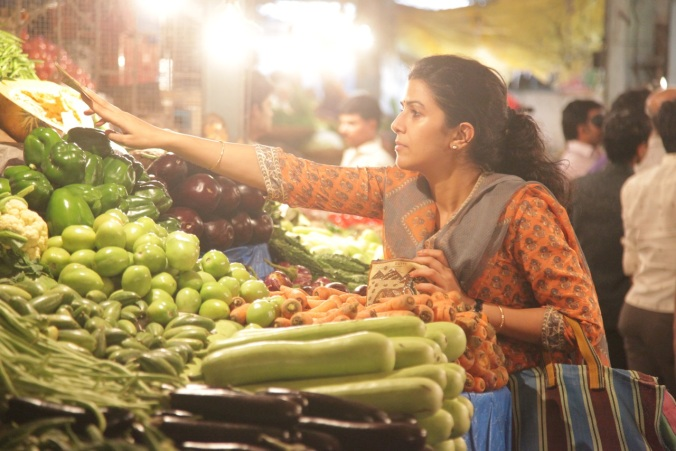 Nimrat Kaur as Ila, choosing the food for her mouthwatering meals