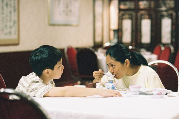 Jaile brings Terry some shark's fin soup at his grandmother's birthday party. Terry has to sit outside the function room because there are no free chairs for her.
