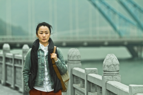 Zhao Tao as the woman who also reaches the end of her tether in A TOUCH OF SIN