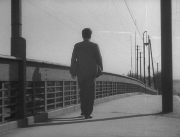 The second tracking shot follows Tokiko's husnand Suichi when he retraces her journey to the brothel. (A tram will pass him on this journey – the closest Ozu offers us to his favourite railway shots.