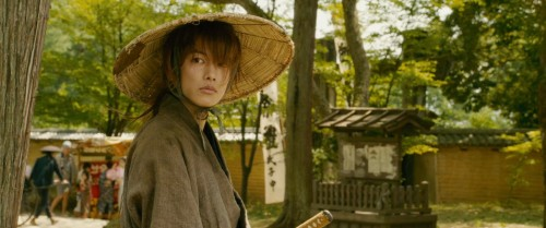Kenshin arrives in town and learns about Kauro's dojo