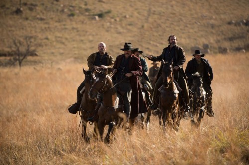 The 'bad guys' with Eric Cantona riding high in the saddle (second right) and lead by