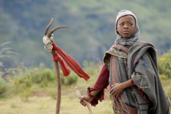 The mysterious orphan boy (played by Lebohang Ntsane)