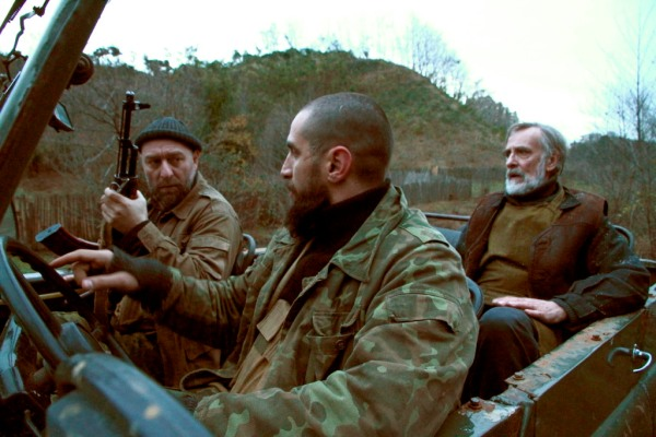 Ivo (in the back of the jeep) with the two Chechen mercenaries. Sortly after, one will be killed and the other wounded.