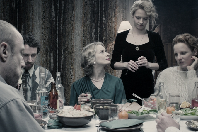 The opening sequence featuring a communal meal with three of the four women in the composition